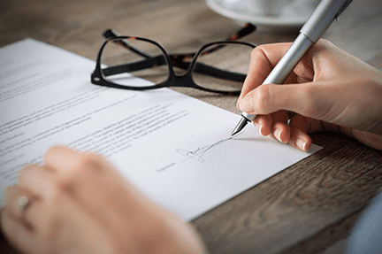 Signing a contract to buy a house in Georgia. The contract is usually signed at what is called a