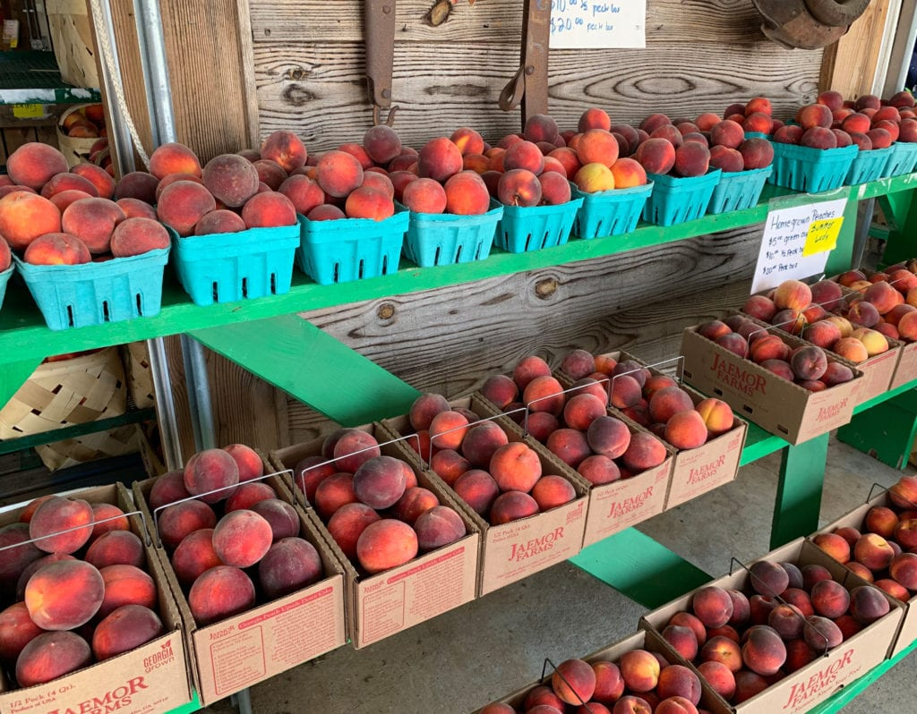 Peaches Displayed in the Front of the Store